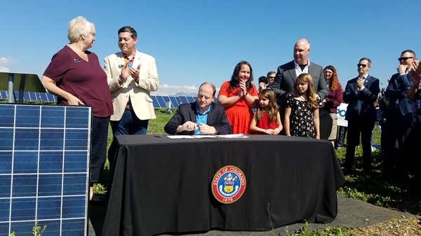CO Gov. Jared Polis signs HB 1260 into law on May 30, 2019